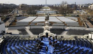 Preparations take place Sunday, Jan. 15, 2017, in Washington, following a rehearsal of the swearing-in ceremony for President-elect Donald Trump. (AP Photo/Patrick Semansky)