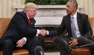 In this Nov. 10, 2016 photo, President Barack Obama and President-elect Donald Trump shake hands following their meeting in the Oval Office of the White House in Washington.   (AP Photo/Pablo Martinez Monsivais)