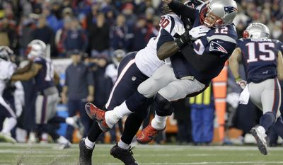 Houston Texans defensive end Jadeveon Clowney (90) levels New England Patriots quarterback Tom Brady (12) after Brady released a pass during the first half of an NFL divisional playoff football game, Saturday, Jan. 14, 2017, in Foxborough, Mass. (AP Photo/Elise Amendola)