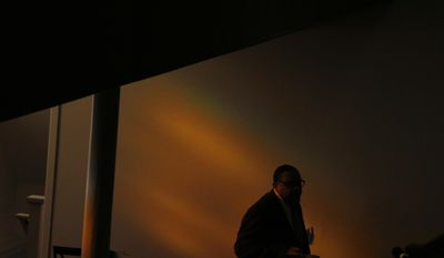A man walks through 16th Street Baptist Church to sit before Attorney General Loretta Lynch speaks, Sunday, Jan. 15, 2017, in Birmingham, Ala. (AP Photo/Brynn Anderson)