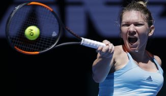 Romania's Simona Halep hits a forehand against Shelby Rogers of the United States during their first round match at the Australian Open tennis championships in Melbourne, Australia, Monday, Jan. 16, 2017. (AP Photo/Aaron Favila)