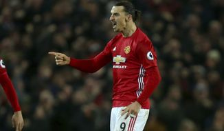 Manchester United's Zlatan Ibrahimovic celebrates scoring his side's first goal during the English Premier League soccer match between Manchester United and Liverpool at Old Trafford stadium in Manchester, England, Sunday, Jan. 15, 2017. (AP Photo/Dave Thompson)