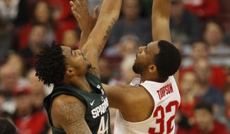 Ohio State center Trevor Thompson, right, goes up to shoot against Michigan State forward Nick Ward during the first half of an NCAA college basketball game in Columbus, Ohio, Sunday, Jan. 15, 2017. (AP Photo/Paul Vernon)