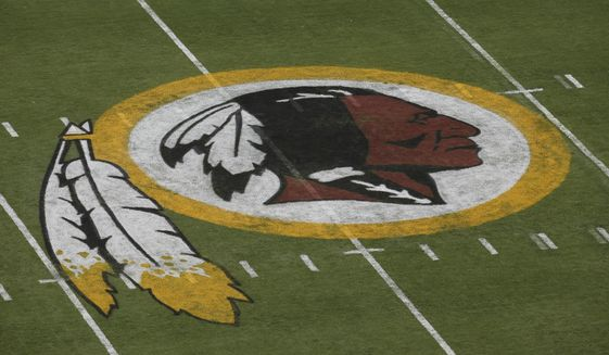 FILE - In this Aug. 7, 2014 file photo, the Washington Redskins logo is seen on the field before an NFL football preseason game against the New England Patriots in Landover, Md. A First Amendment fight will play out Wednesday, Jan. 18, 2017,  in the Supreme Court as the justices consider whether a law barring disparaging trademarks violates free speech rights.  (AP Photo/Alex Brandon, File)