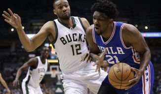 Philadelphia 76ers' Joel Embiid tries to drive past Milwaukee Bucks' Jabari Parker during the first half of an NBA basketball game Monday, Jan. 16, 2017, in Milwaukee. (AP Photo/Morry Gash)