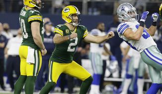 Green Bay Packers kicker Mason Crosby (2) watches his 51-yard field goal to win the game as time expires during the second half of an NFL divisional playoff football game Sunday, Jan. 15, 2017, in Arlington, Texas. The Packers won 34-31. (AP Photo/LM Otero)