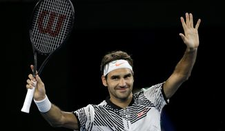 Switzerland's Roger Federer celebrates after defeating Austria's Jurgen Melzer in their first round match at the Australian Open tennis championships in Melbourne, Australia, Monday, Jan. 16, 2017. (AP Photo/Aaron Favila)