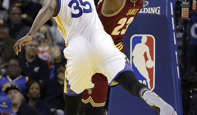 Golden State Warriors' Kevin Durant (35) blocks the shot of Cleveland Cavaliers' LeBron James, right, during the second half of an NBA basketball game Monday, Jan. 16, 2017, in Oakland, Calif. (AP Photo/Ben Margot)