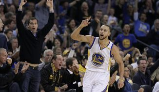 Golden State Warriors' Stephen Curry celebrates a score against the Cleveland Cavaliers during the first half of an NBA basketball game, Monday, Jan. 16, 2017, in Oakland, Calif. (AP Photo/Ben Margot)