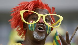 Togo supporters chant before the African Cup of Nations Group C soccer match between Ivory Coast and Togo at the Stade de Oyem in Oyem, Gabon, Monday Jan. 16, 2017. (AP Photo/Sunday Alamba)