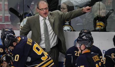 Buffalo Sabres coach Dan Bylsma points down ice during the third period of an NHL hockey game, Monday, Jan. 16, 2017, in Buffalo, N.Y. (AP Photo/Jeffrey T. Barnes)