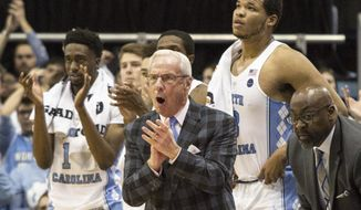 North Carolina Head Coach Roy Williams shouts toward his team during the first half of an NCAA college basketball game against Syracuse in Chapel Hill, N.C., Monday, Jan. 16, 2017. (AP Photo/Ben McKeown)
