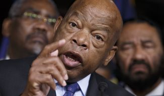In this file July 8, 2016 file photo, civil rights leader Rep. John Lewis, D-Ga., and other members of the Congressional Black Caucus participate in a news conference on Capitol in Washington. (AP Photo/J. Scott Applewhite, File)