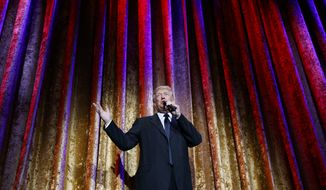 President-elect Donald Trump speaks during the presidential inaugural Chairman's Global Dinner, Tuesday, Jan. 17, 2017, in Washington. (AP Photo/Evan Vucci)