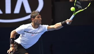 Spain's Rafael Nadal makes a forehand return to Germany's Florian Mayer during their first round match at the Australian Open tennis championships in Melbourne, Australia, Tuesday, Jan. 17, 2017. (AP Photo/Andy Brownbill)
