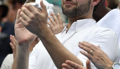 Reddit co-founder Alexis Ohanian applauds as he watches his fiancee United States' Serena Williams defeat Switzerland's Belinda Bencic in her first round match at the Australian Open tennis championships in Melbourne, Australia, Tuesday, Jan. 17, 2017. (AP Photo/Andy Brownbill)