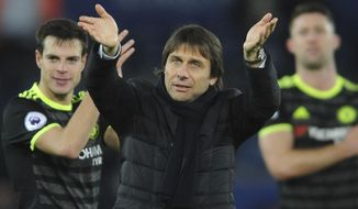 Chelsea manager Antonio Conte celebrates towards fans after the English Premier League soccer match between Leicester City and Chelsea at the King Power Stadium in Leicester, England, Saturday, Jan. 14, 2017. (AP Photo/Rui Vieira)