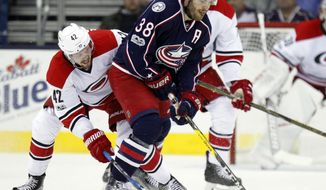 Columbus Blue Jackets forward Boone Jenner, right, works for the puck against Carolina Hurricanes forward Joakim Nordstrom, of Sweden, during the first period of an NHL hockey game in Columbus, Ohio, Tuesday, Jan. 17, 2017. (AP Photo/Paul Vernon)