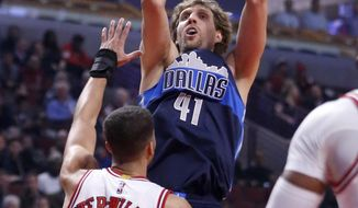 Dallas Mavericks' Dirk Nowitzki shoots over Chicago Bulls' Michael Carter-Williams during the first half of an NBA basketball game, Tuesday, Jan. 17, 2017, in Chicago. (AP Photo/Charles Rex Arbogast)