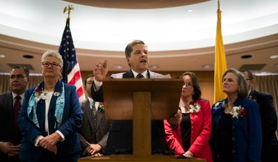 State Sen. Joseph Cervantes, center, joined by his senate Democratic members from left, Liz Stefanics, Mimi Stewart and Mary Kay Papen gives their response to New Mexico Gov. Susana Martinez's State of the State address, Tuesday, Jan. 17, 2017, in Santa Fe, N.M. (AP Photo/Craig Fritz)