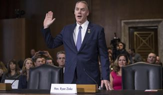 Interior Secretary-designate, Rep. Ryan Zinke, R-Mont., is sworn in on Capitol Hill in Washington, Tuesday, Jan. 17, 2017, prior to testifying at his confirmation hearing before the Senate Energy and Natural Resources Committee. Zinke, 55, a former Navy SEAL who just won his second term in Congress, was an early supporter of President-elect Donald Trump and, like his prospective boss, has expressed skepticism about the urgency of climate change. (AP Photo/J. Scott Applewhite)