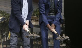 Golden State Warriors head coach Steve Kerr, left, and forward Kevin Durant shovel dirt while posing for photos during a ground breaking ceremony for the Chase Center in San Francisco, Tuesday, Jan. 17, 2017. (AP Photo/Jeff Chiu)