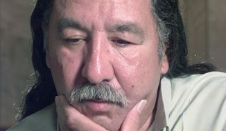FILE - In this April 29, 1999, file photo, American Indian activist Leonard Peltier speaks during an interview at the U.S. Penitentiary at Leavenworth, Kan. Longtime supporters of Peltier are hoping President Barack Obama will grant him clemency before leaving office. Peltier is serving two life sentences for the 1975 shooting deaths of two FBI agents during a standoff on South Dakota's Pine Ridge Indian Reservation. (Joe Ledford/The Kansas City Star via AP, File)