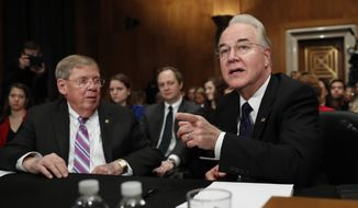 Health and Human Services Secretary-designate, Rep. Tom Price, R-Ga., accompanied by Sen. Johnny Isakson, R-Ga., who introduced him, speaks on Capitol Hill in Washington, Wednesday, Jan. 18, 2017, at his confirmation hearing before the Senate Health, Education, Labor and Pensions Committee. (AP Photo/Carolyn Kaster)