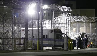 An ambulance exits the secure area after the execution of Ricky Gray at the Greensville Correctional Center in Jarratt, Va., Wednesday, Jan. 18, 2017. Gray who was convicted of killing a couple and their two young daughters in their Virginia home on New Year's Day 2006 was put to death Wednesday. (AP Photo/Steve Helber)
