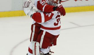 Detroit Red Wings goalie Petr Mrazek celebrates with Tomas Tatar (21) after stopping a Boston Bruins shot in a shootout during an NHL hockey game Wednesday, Jan. 18, 2017, in Detroit. Detroit won 6-5. (AP Photo/Paul Sancya)