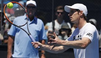 Britain's Andy Murray, right, is watched by his coach Ivan Lendl during a practice session at the Australian Open tennis championships in Melbourne, Australia, Thursday, Jan. 19, 2017. Murray will play United States' Sam Querrey in third round match on Friday, Jan. 20. (AP Photo/Dita Alangkara)
