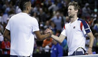 Australia's Nick Kyrgios, left, congratulates Italy's Andreas Seppi after winning their second round match at the Australian Open tennis championships in Melbourne, Australia, Wednesday, Jan. 18, 2017. (AP Photo/Aaron Favila)