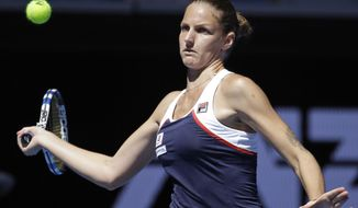 Karolina Pliskova of the Czech Republic makes a forehand return to Russia's Anna Blinkova during their second round match at the Australian Open tennis championships in Melbourne, Australia, Thursday, Jan. 19, 2017. (AP Photo/Aaron Favila)