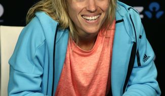 Germany's Angelique Kerber smiles at a press conference following her second round win over compatriot Carina Witthoeft at the Australian Open tennis championships in Melbourne, Australia, Wednesday, Jan. 18, 2017. (AP Photo/Mark Baker)