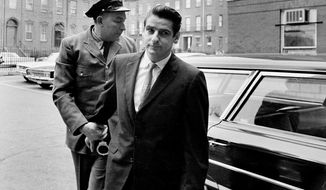 FILE - In this Jan. 10, 1967, file photo shows Albert DeSalvo, right, arrives for a court appearance in Cambridge, Mass. Fifty years ago a judge sentenced DeSalvo, a factory worker who claimed he was the notorious Boston Strangler, but questions still swirl around DeSalvo's confession. (AP Photo, File)