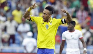 Gabon's, Pierre Emerick Aubameyang, left, celebrates after scoring, during the African Cup of Nations Group A soccer match between Gabon and Burkina Faso at the Stade de l'Amitie, in Libreville, Gabon Wednesday Jan. 18, 2017. (AP Photo/Sunday Alamba)