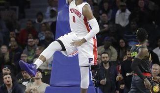 Detroit Pistons center Andre Drummond (0) dunks during the first half of an NBA basketball game against the Atlanta Hawks, Wednesday, Jan. 18, 2017, in Auburn Hills, Mich. (AP Photo/Carlos Osorio)