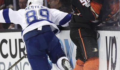 Tampa Bay Lightning's Nikita Nesterov, left, of Russia, avoids a check by Anaheim Ducks' Antoine Vermette during the second period of an NHL hockey game Tuesday, Jan. 17, 2017, in Anaheim, Calif. (AP Photo/Jae C. Hong)