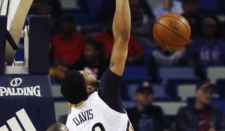 New Orleans Pelicans forward Anthony Davis (23) makes a dunk against Orlando Magic guard Jodie Meeks (20) in the first half of an NBA basketball game in New Orleans, Wednesday, Jan. 18, 2017. (AP Photo/Max Becherer)