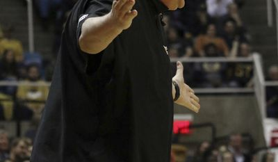 West Virginia University Coach Bob Huggins yells during the first half of an NCAA college basketball game, Wednesday, Jan. 18, 2017, in Morgantown, W.Va. (AP Photo/Lindsay Cook)