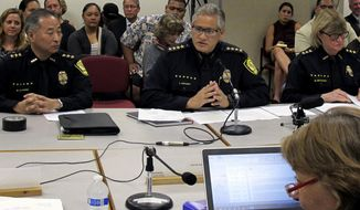 FILE - In this Sept. 30, 2014, file photo, Honolulu Police Chief Louis Kealoha, center, addresses Hawaii lawmakers as Deputy Chief Dave Kajihiro, left, and Deputy Chief Marie McCauley, right, and state Sen. Rosalyn Baker, foreground, listen during hearing at the state Capitol in Honolulu. The Honolulu Police Commission was meeting behind closed doors Wednesday, Jan. 18, 2017, to discuss a retirement deal that Kealoha could get to walk away from the department while he's the target of a federal investigation involving allegations of civil rights abuses and corruption. (AP Photo/Jennifer Sinco Kelleher, File)