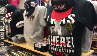 Donald Trump's surprise win over Hillary Clinton in November's election prompted the owner of White House gifts in the District to make a mad scramble to replace his Clinton T-shirts with Trump shirts and baseball caps. (Photographs by Julia Brouillette/The Washington Times)