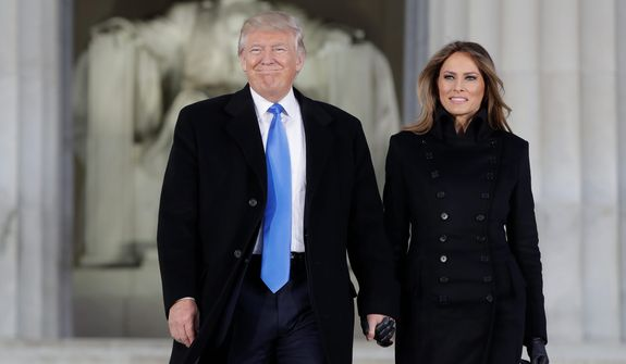 """President-elect Donald Trump and his wife, Melania, were greeted by a rousing crowd as they arrived at a pre-inaugural concert Thursday evening at the Lincoln Memorial. Mr. Trump promised to unify the country and said he was """"just the messenger"""" for Americans who felt left behind or let down by their government. (Associated Press)"""