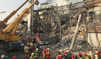 Iranian firefighters work at the scene of the collapsed Plasco building after being engulfed by a fire, in central Tehran, Iran, Thursday, Jan. 19, 2017. A high-rise building in Tehran engulfed by a fire collapsed on Thursday as scores of firefighters battled the blaze. (AP Photo/Ebrahim Noroozi)