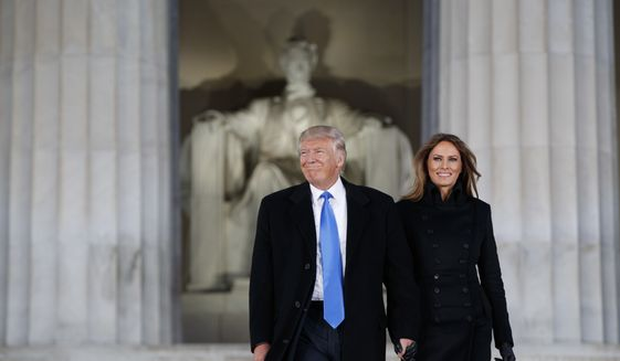 """President-elect Donald Trump, left, and his wife Melania Trump arrive to the """"Make America Great Again Welcome Concert"""" at the Lincoln Memorial, Thursday, Jan. 19, 2017, in Washington. (AP Photo/Evan Vucci)"""