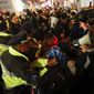 Protestors scuffle with police after refusing to vacate the sidewalk in front of the National Press Club Building ahead of the presidential inauguration, Thursday, Jan. 19, 2017, in Washington. (AP Photo/John Minchillo)