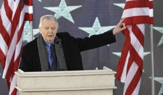"Jon Voight waves as he appears during a pre-Inaugural ""Make America Great Again! Welcome Celebration"" at the Lincoln Memorial in Washington, Thursday, Jan. 19, 2017. (AP Photo/David J. Phillip)"