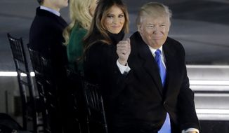 "President-elect Donald Trump and his wife Melania Trump attend a pre-Inaugural ""Make America Great Again! Welcome Celebration"" at the Lincoln Memorial in Washington, Thursday, Jan. 19, 2017. (AP Photo/David J. Phillip)"