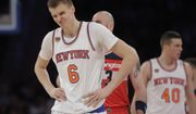 New York Knicks' Kristaps Porzingis (6) reacts to a call during the second half of the team's NBA basketball game against the Washington Wizards on Thursday, Jan. 19, 2017, in New York. The Wizards won 113-110. (AP Photo/Frank Franklin II)