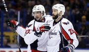 Washington Capitals' Jay Beagle, left, is congratulated by Daniel Winnik after scoring during the first period of the team's NHL hockey game against the St. Louis Blues on Thursday, Jan. 19, 2017, in St. Louis. (AP Photo/Jeff Roberson)